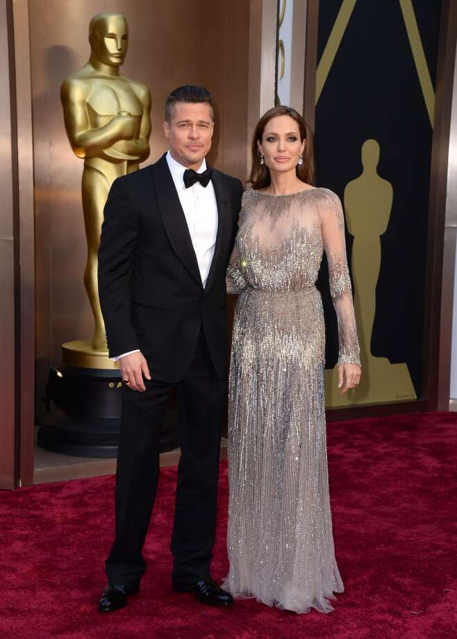 Brad Pitt, left, and Angelina Jolie arrive at the Oscars on Sunday, March 2, 2014, at the Dolby Theatre in Los Angeles. Photo: Jordan Strauss, Associated Press