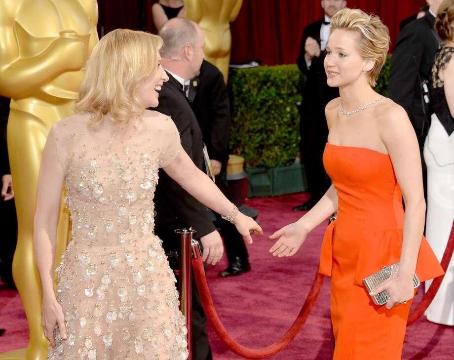 Actresses Cate Blanchett (L) and Jennifer Lawrence attend the Oscars held at Hollywood & Highland Center on March 2, 2014 in Hollywood, California. Photo: Michael Buckner, Getty Images
