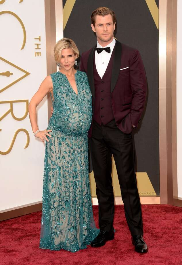 Worst: Elsa Pataky Baby bump gowns gone green, sparkly, stretchy and ill-fitting. And Chris Hemsworth isn't doing her any favors with that tux.  Photo: Jason Merritt, Getty Images