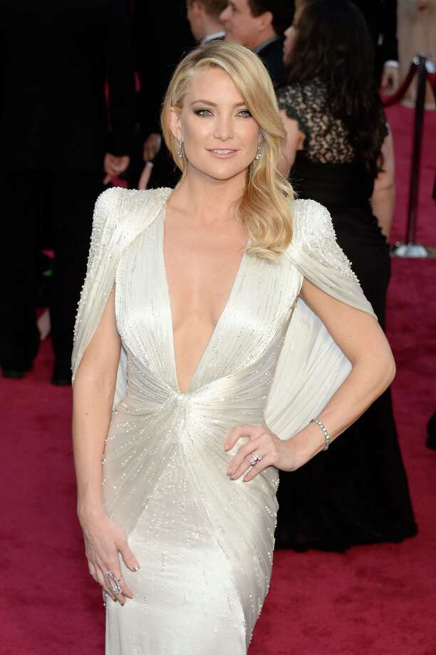 Kate Hudson's silk satin gown with padded shoulders combined trendy white with the glamour of yesteryear. Photo: Kevork Djansezian, Getty Images / 2014 Getty Images