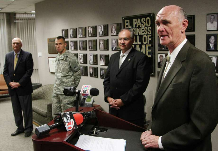 El Paso Mayor John Cook, right, presents a report that says Ft. Bliss has a $6 billion dollar economic impact from automatic budget cuts during a news conference Friday, March 8, 2013 in El Paso, Texas. He is joined by Tom Thomas, left, Civilian Aide to the Secretary of the Army for West Texas, Maj. Joe Buccino, Public Information Officer for Fort Bliss, center, and Rick Glancey, Chairman of the Greater El Paso Chamber of Commerce's Armed Forces Division at the Greater EL Paso Chamber of Commerce. West Texas officials plan to meet Pentagon leaders and Legislators next week to ask them to spare the military installation from budget cuts. (AP Photo/Juan Carlos Llorca) Photo: Juan Carlos Llorca, STF / AP