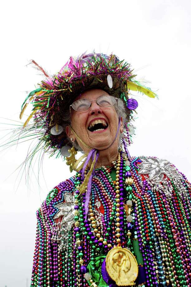"""I've got on 30-pounds of beads,"" Liz Beaulieu, 92, said while watching hundreds of pets and their owners  parade down the Seawall during the Krewe of Barkus & Meoux Parade, one of many parades during  Mardi Gras! Galveston festivities Sunday, March 2, 2014, in Galveston.  The Galveston Island Humane Society began the Krewe of Barkus and Meoux Parade in 1998 as a way to involve the community in the spirit of Mardi Gras and feature their family pets. Photo: Johnny Hanson, Houston Chronicle / © 2014  Houston Chronicle"