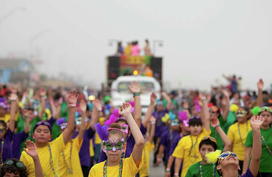 Daisy Rosales, 10, center and the Scroggin's Elementary Toe-Tappers perform along the Seawall during the Mardi Gras Children's Parade, one of many parades during  Mardi Gras! Galveston festivities Sunday, March 2, 2014, in Galveston. Photo: Johnny Hanson, Houston Chronicle / © 2014  Houston Chronicle