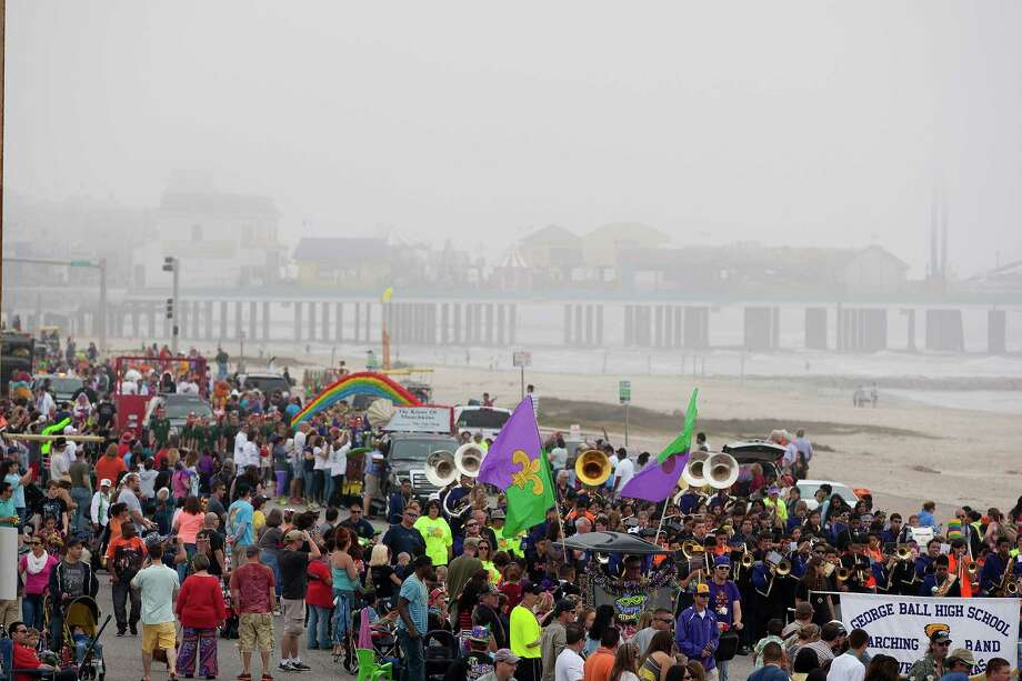 The George Ball High School Marching Band performs along the Seawall during the Mardi Gras Children's Parade, one of many parades during  Mardi Gras! Galveston festivities Sunday, March 2, 2014, in Galveston. Photo: Johnny Hanson, Houston Chronicle / © 2014  Houston Chronicle