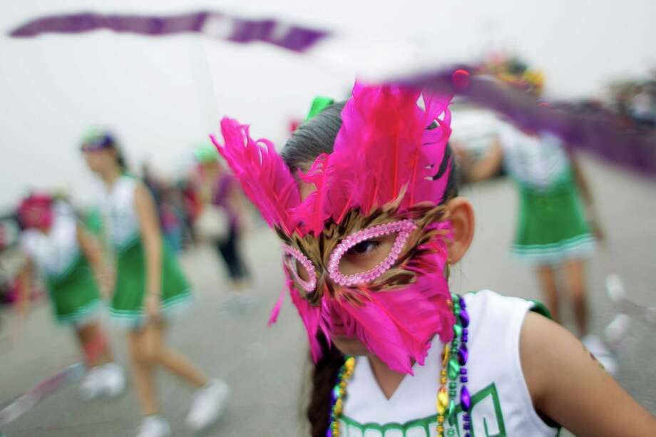 Casandra Plata, 7, and the Scroggin's Elementary Toe-Tappers perform along the Seawall during the Mardi Gras Children's Parade, one of many parades during  Mardi Gras! Galveston festivities Sunday, March 2, 2014, in Galveston. Photo: Johnny Hanson, Houston Chronicle / © 2014  Houston Chronicle