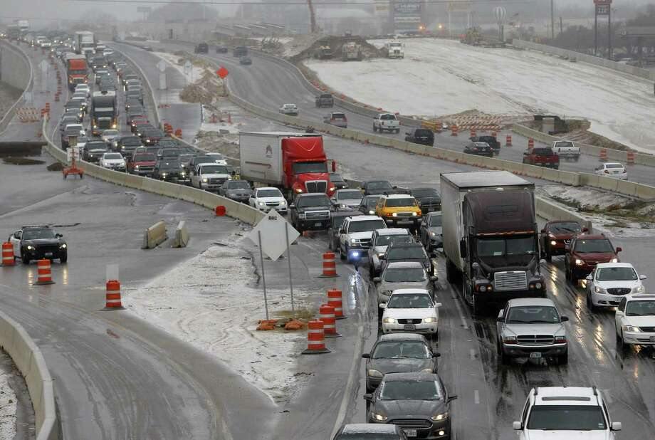 Traffic backs up on Texas 121 in Hurst. The National Weather Service issued a winter storm warning, with freezing rain and sleet, for North Texas on Sunday. Photo: Associated Press / The Fort Worth Star-Telegram