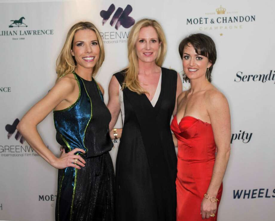"Left to right; Carina Crain, CEO, Wendy Stapleton Reyes, Executive Director, and Colleen deVeer, Director of Programing, of the Greenwich International Film Festival organization pose for a photo at their event  ""An Evening With Oscar"" Academy Awards viewing party at the JHouse in the Riverside section of Greenwich, CT on Sunday, March, 2nd, 2014. Photo: Mark Conrad / Connecticut Post Freelance"