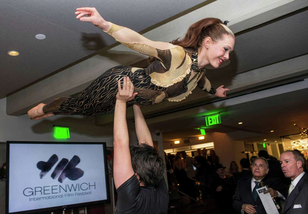 Acrobats Laura Witner and Chris Pelgado perform for the guests at the Greenwich International Film Festival organization's