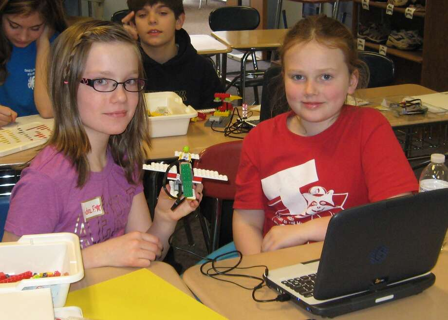 Kendra Freer, left, and Nessa Corcoran are among the nearly 50 young people who attended the Feb. 15 Rensselaer County 4-H Teen Council pre-teen fun day at Tamarac Middle School. It was a day of science and technology and math topics taught by the Teen Council Teens to younger 4-H members, which featured Lego robotics. (Kandis Freer)