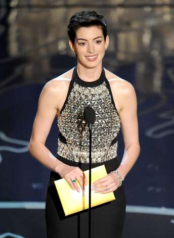 Actress Anne Hathaway speaks onstage during the Oscars at the Dolby Theatre on March 2, 2014 in Hollywood