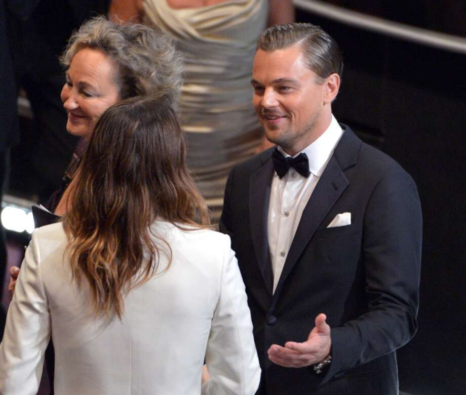 Jared Leto, left, and Leonardo DiCaprio appear in the audience at the Oscars at the Dolby Theatre on Sunday, March 2, 2014, in Los Angeles. Photo: John Shearer, Associated Press