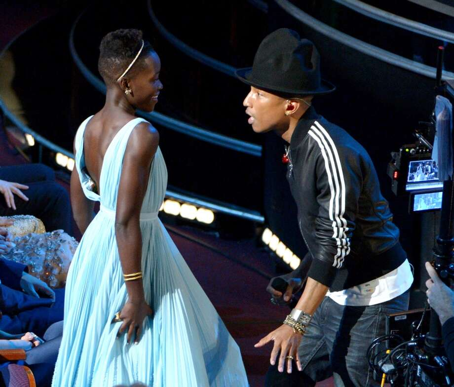 "Lupita Nyong'o, left, dances along with Pharrell Williams during his performance of ""Happy"" at the Oscars at the Dolby Theatre on Sunday, March 2, 2014, in Los Angeles. Photo: John Shearer, Associated Press"