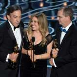 (L-R) Producer Peter Del Vecho, directors Jennifer Lee and Chris Buck accept the Best Animated Feature Film award for 'Frozen' onstage during the Oscars at the Dolby Theatre on March 2, 2014 in Hollywood, California.