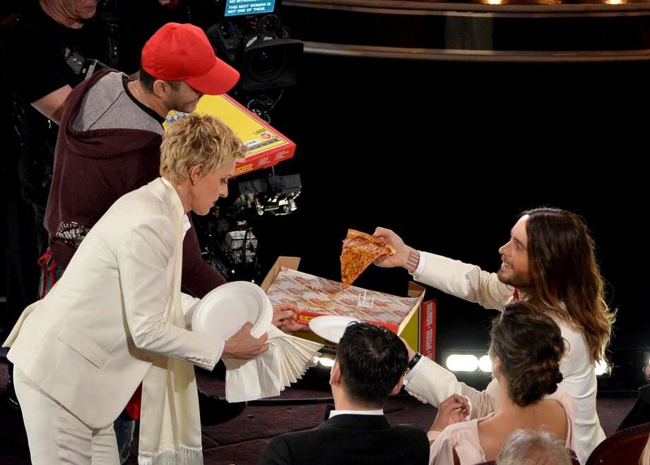 Host Ellen DeGeneres (L) and actor Jared Leto onstage during the Oscars at the Dolby Theatre on March 2, 2014 in Hollywood, California. Photo: Kevin Winter, Getty Images