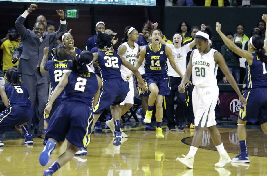 The bench for No. 11 West Virginia erupts in celebration after upsetting No. 6 Baylor 71-69 in Waco. Photo: LM Otero / Associated Press / AP