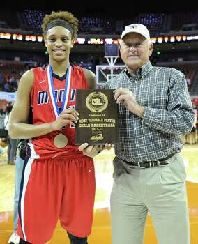 Manvel's Brianna Turner (11) is presented with the MVP Award by baseball hall of fame's Nolan Ryan during the UIL 5A state final girls basketball game between Manvel and Duncanville high schools on Sat., March 1, 2014 at the Frank Erwin Center in Austin, TX. (Ashley Landis/Special contributor) Photo: Ashley Landis, Photographer / ©Ashley Landis