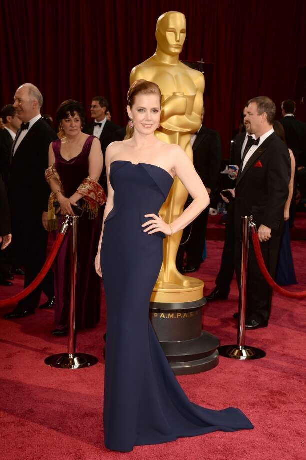 Worst. While the tailoring of this navy Gucci Couture gown on Amy Adams is unbeatable, her overall look is not. While she said she was channeling Kim Novak in Vertigo, her matronly  hair and washed-out makeup had us wishing she'd grab her smelling salts. Photo: Frazer Harrison, Getty Images