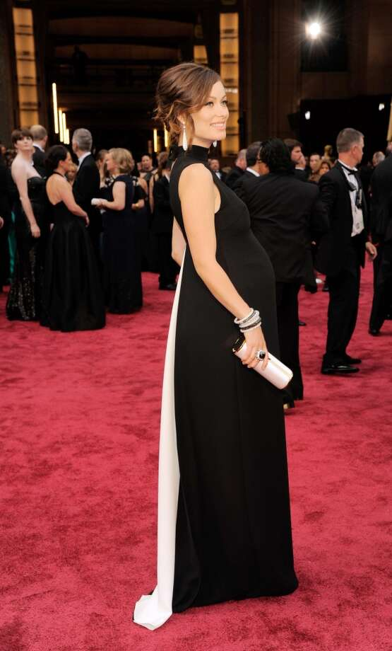 Best. An expecting Olivia Wilde, in Valentino, looked modern and beautiful in a black column dress that kept the attention on her glowing face—and white drop earrings. Photo: Chris Pizzello, Associated Press