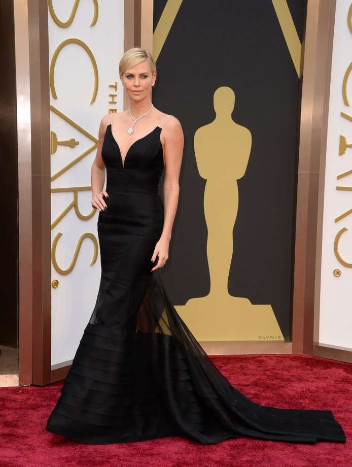 Best. A regularly stunning awards ceremony beauty, Charlize Theron maintained her best-dressed record with a black Dior that gave the illusion of strapless—with a twist. Photo: Jordan Strauss, Associated Press