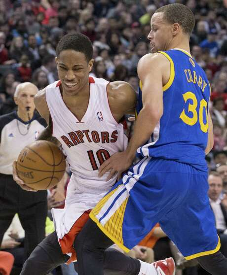 Toronto's DeMar DeRozan (left), driving past Golden State's Stephen Curry, scored 32 points to help the Raptors beat Curry for the first time. Photo: Chris Young / Associated Press / The CanadianPress