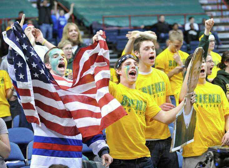 Siena fans cheer their team against Monmouth during the second half of an NCAA college basketball in