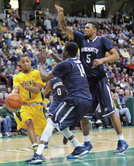 Siena's Rich Audu (1) moves the ball against Monmouth during the first half of an NCAA college baske