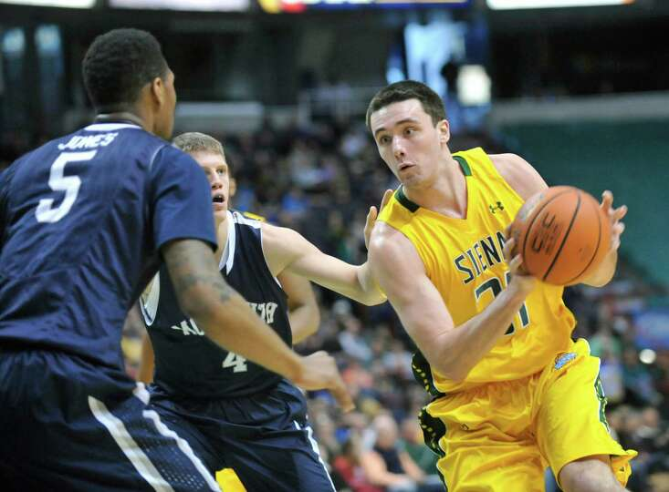 Siena's Brett Bisping (31) moves the ball against Monmouth during the first half of an NCAA college