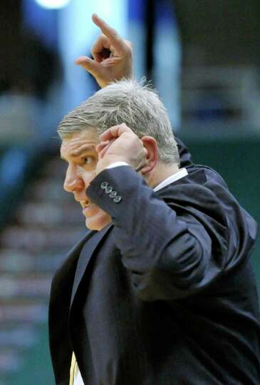 Siena head coach Jimmy Patsos coaches his players against Monmouth during the second half of an NCAA