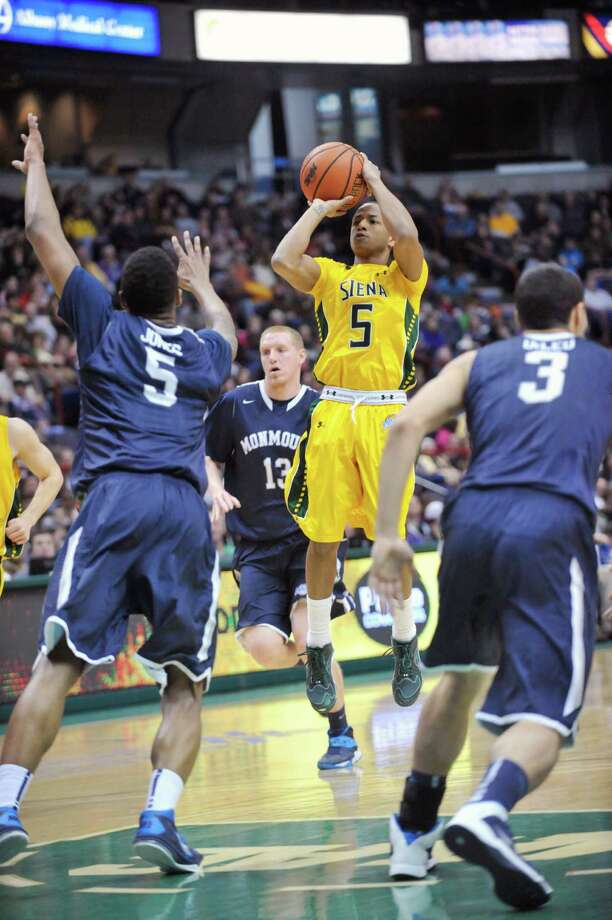 Siena's Evan Hymes (5) puts up a shot against Monmouth during the first half of an NCAA college basketball in Albany, N.Y., Sunday, March 2, 2014. (Hans Pennink / Special to the Times Union) ORG XMIT: HP108 Photo: Hans Pennink / Hans Pennink