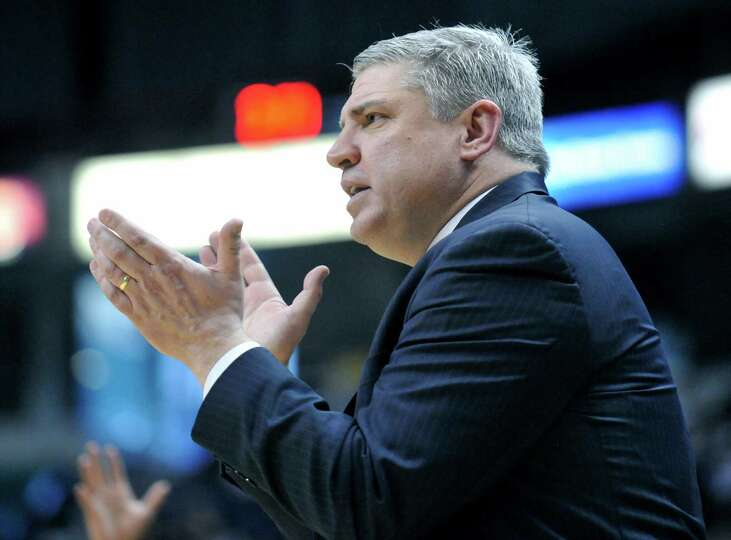 Siena head coach Jimmy Patsos coahes his players against Monmouth during the second half of an NCAA