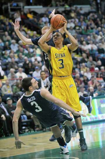 Siena's Ryan Oliver (3) puts up a shot against Monmouth during the second half of an NCAA college ba