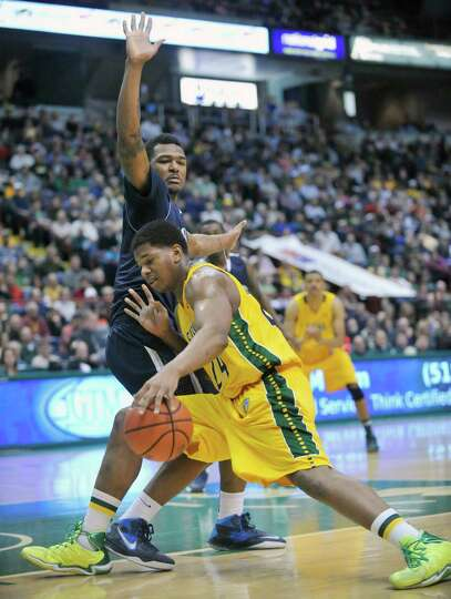 Siena's Lavon Long (24) moves the ball against Monmouth during the first half of an NCAA college bas