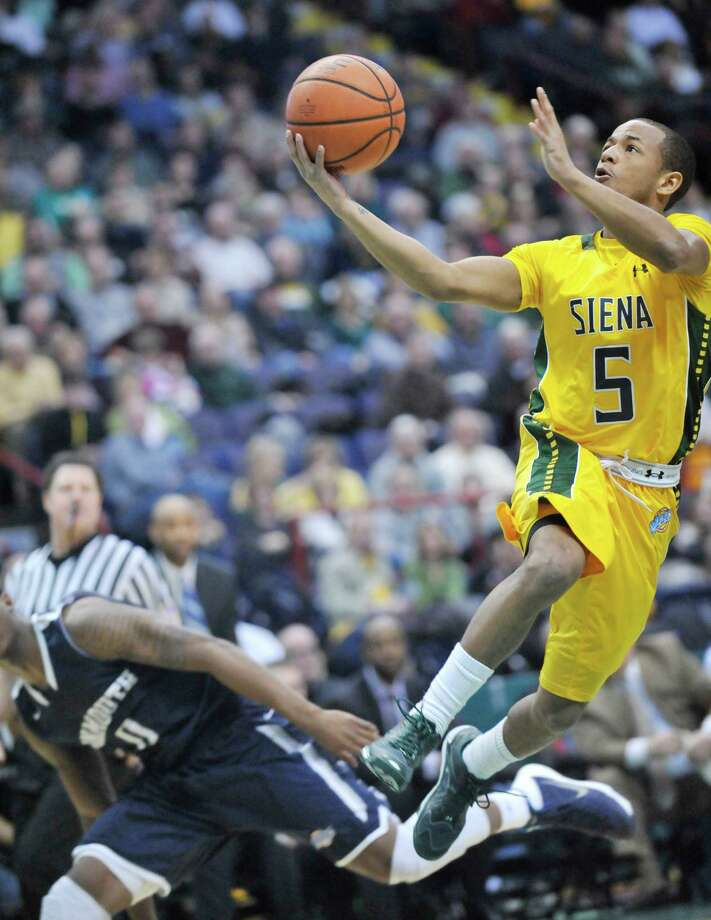 Siena's Evan Hymes (5) puts up a shot against Monmouth during the first half of an NCAA college basketball in Albany, N.Y., Sunday, March 2, 2014. (Hans Pennink / Special to the Times Union) ORG XMIT: HP113 Photo: Hans Pennink / Hans Pennink