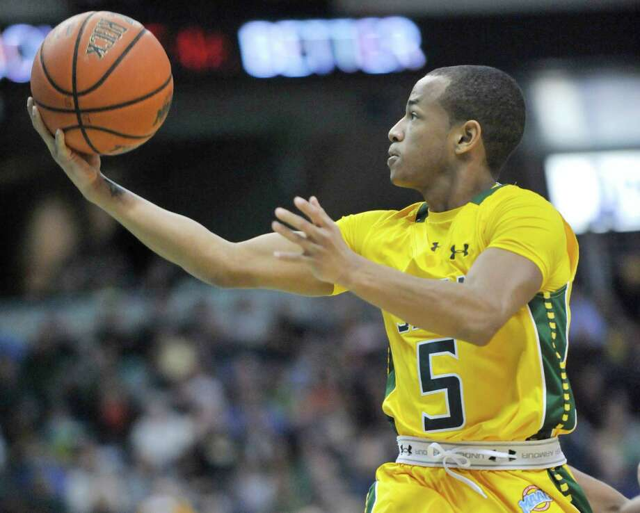 Siena's Evan Hymes (5) puts up a shot against Monmouth during the first half of an NCAA college basketball in Albany, N.Y., Sunday, March 2, 2014. (Hans Pennink / Special to the Times Union) ORG XMIT: HP114 Photo: Hans Pennink / Hans Pennink