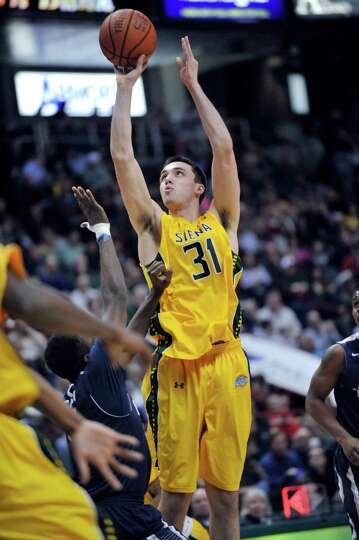 Siena's Brett Bisping (31) puts a shot up against Monmouth during the second half of an NCAA college