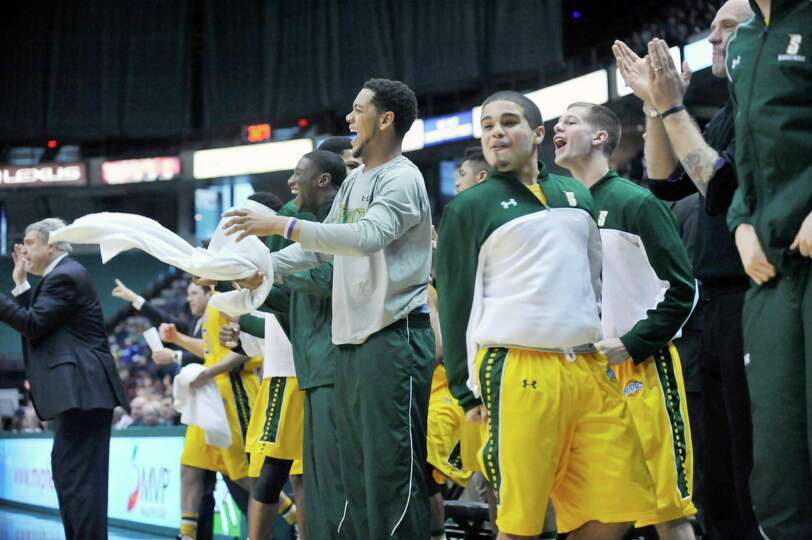 Siena players celebrate a point against Monmouth during the second half of an NCAA college basketbal