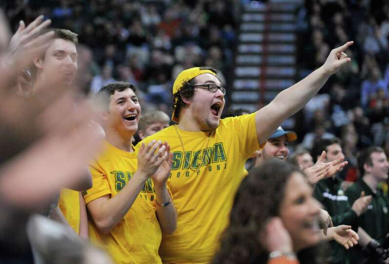 Siena fans cheer for Siena against Monmouth during the second half of an NCAA college basketball in