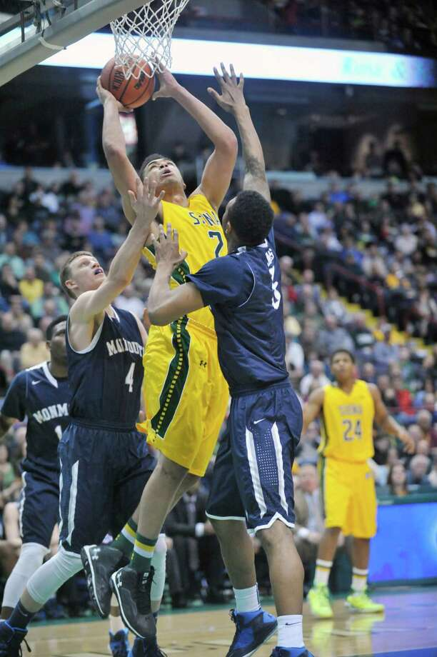 Siena's Javion Ogunyemi (2) puts up a shot against Monmouth during the first half of an NCAA college basketball in Albany, N.Y., Sunday, March 2, 2014. (Hans Pennink / Special to the Times Union) ORG XMIT: HP120 Photo: Hans Pennink / Hans Pennink