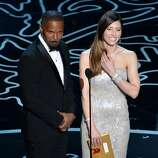 Actors Jamie Foxx (L) and Jessica Biel speak onstage during the Oscars at the Dolby Theatre on March 2, 2014 in Hollywood, California.