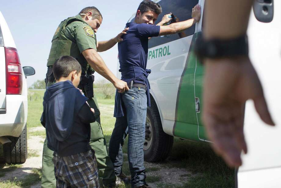 Border Patrol agents escort a 4-year-old boy from Honduras and his 17-year-old uncle after the two crossed the Rio Grande last month in Mission. The number of unaccompanied youths detained by the Border Patrol in 2013 has tripled in three years. Photo: Johnny Hanson / Houston Chronicle / © 2014  Houston Chronicle