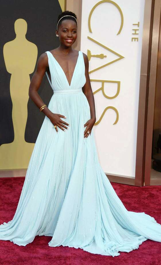 Lupita Nyong'o proved she is the fashion star of this awards season. The pastel blue in her Prada gown paid homage to Nairobi. Photo: Associated Press,  Getty Images And Los Angeles Times Photos / Invision