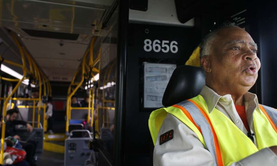 MUNI operator Charles Davis, known to many as the singing bus driver, sings the Ulloa stop on the 29 Sunset in San Francisco, Calif. Photo: Mike Kepka , The Chronicle