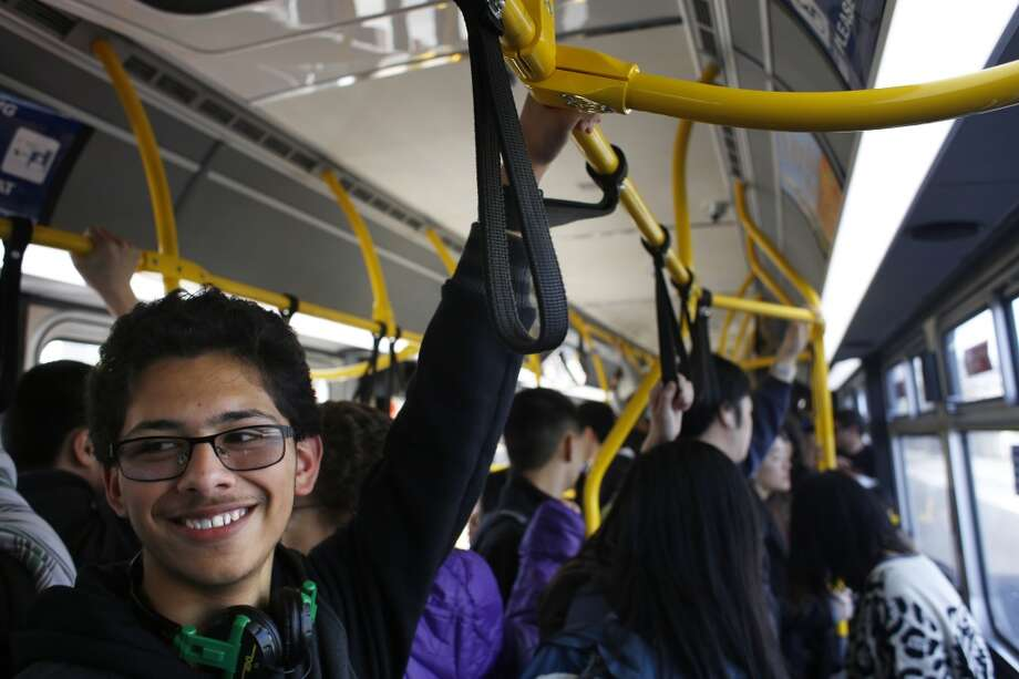 Lowell High School student Mario Ortega, 17, smiles as MUNI operator Charles Davis sings out a stop on the 29 Sunset in San Francisco, Calif. Photo: Mike Kepka, The Chronicle