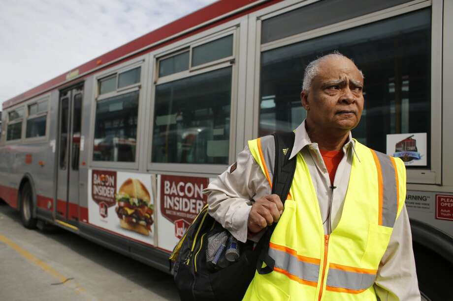MUNI operator Charles Davis, known to many as the singing bus driver, looks for his bus assignment at the MUNI Woods division in San Francisco, Calif. Photo: Mike Kepka, The Chronicle