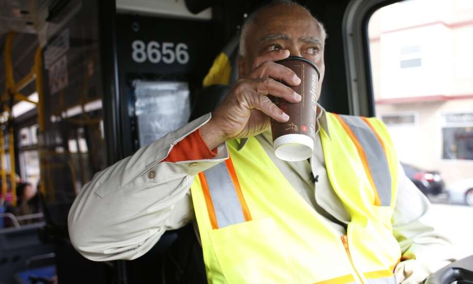 During a break in driving, MUNI operator Charles Davis, the singing bus driver, lubricates his singing voice with coffee in San Francisco, Calif. Photo: Mike Kepka, The Chronicle