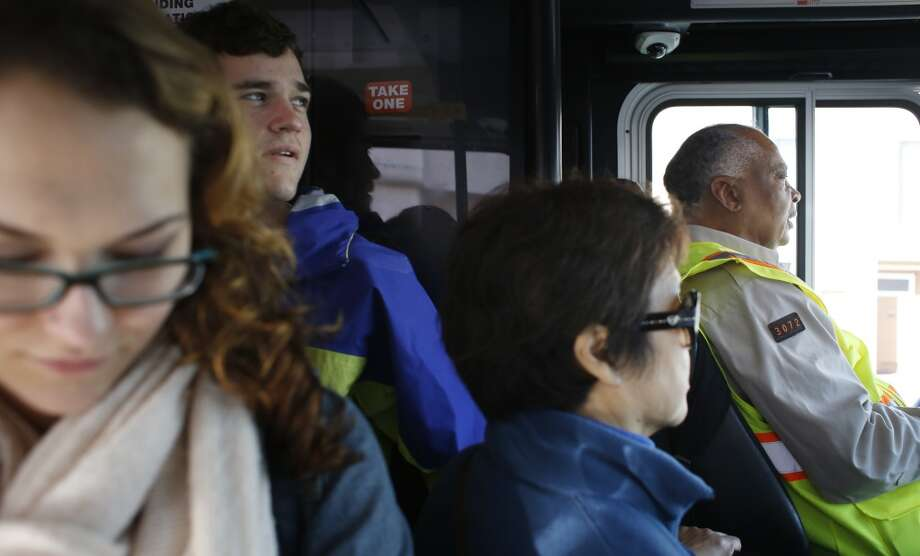 Riders edge up to the yellow line on a crowded 29 sunset bus as MUNI operator Charles Davis sings out the next stop on his route in San Francisco, Calif. Photo: Mike Kepka, The Chronicle