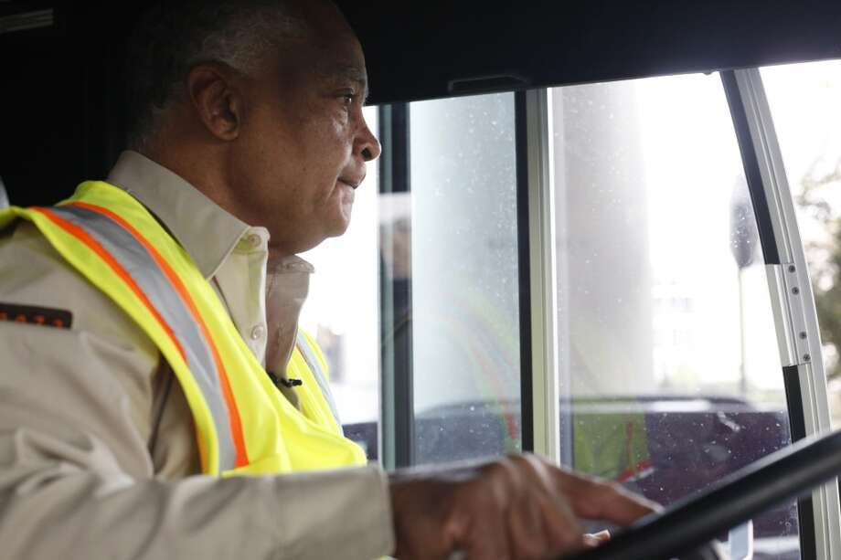 Ready to start his day, MUNI operator Charles Davis, known to many as the singing bus driver, pulls out of the bus terminal in San Francisco, Calif. Photo: Mike Kepka, The Chronicle