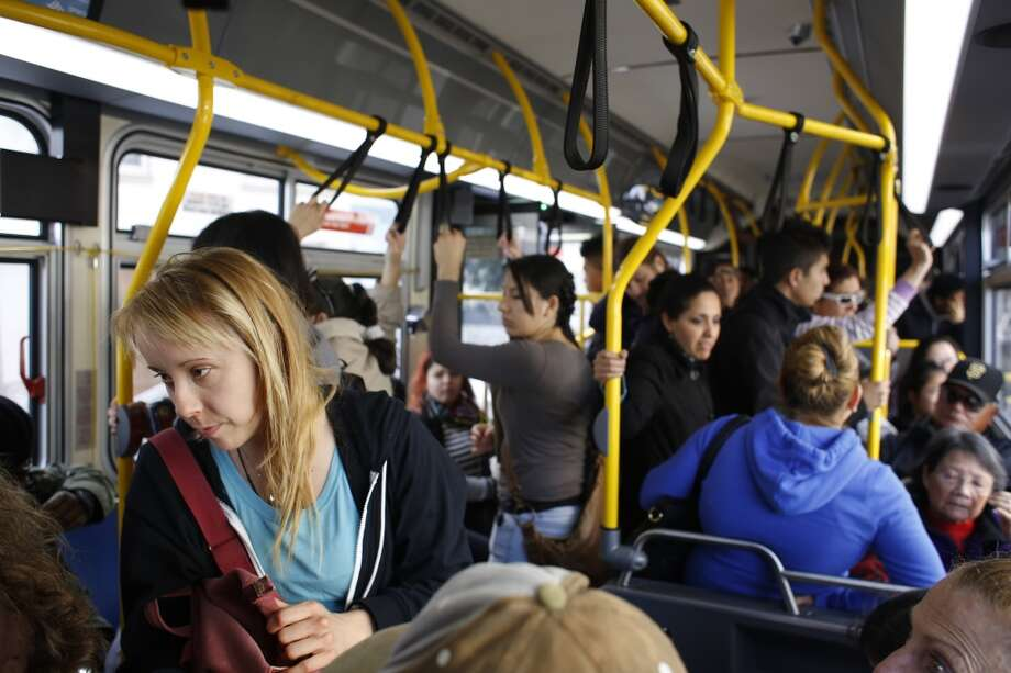 Riders come and go on a crowded 29 Sunset bus driven by Charles Davis in San Francisco, Calif. Photo: Mike Kepka, The Chronicle