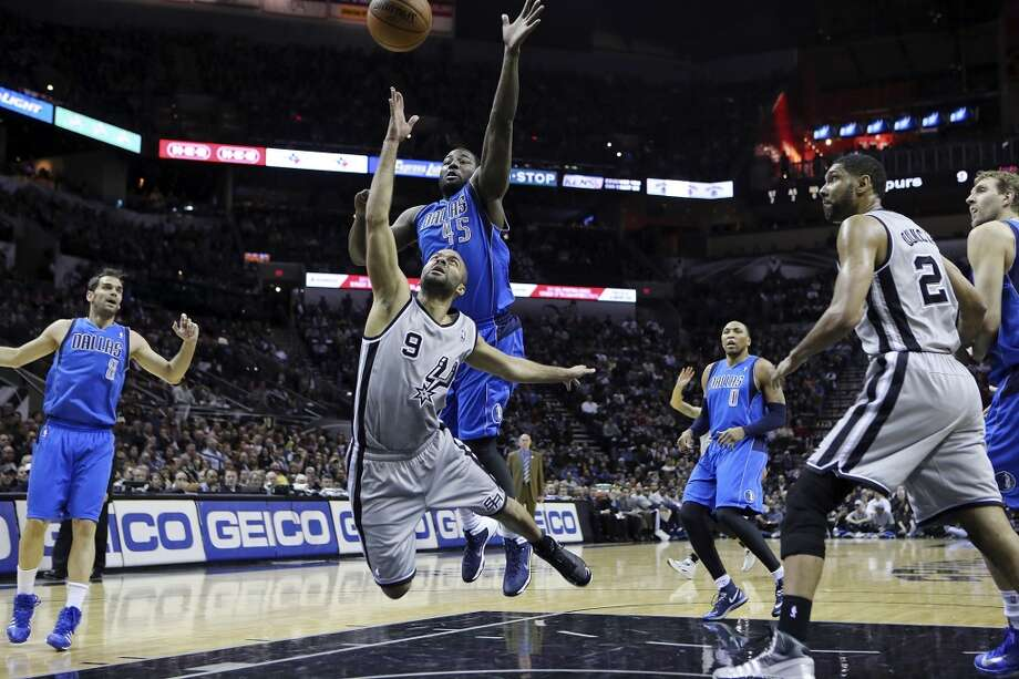 San Antonio Spurs' Tony Parker shoots around Dallas Mavericks' DeJuan Blair during first half action Sunday March 2, 2014 at the AT&T Center. Photo: San Antonio Express-News