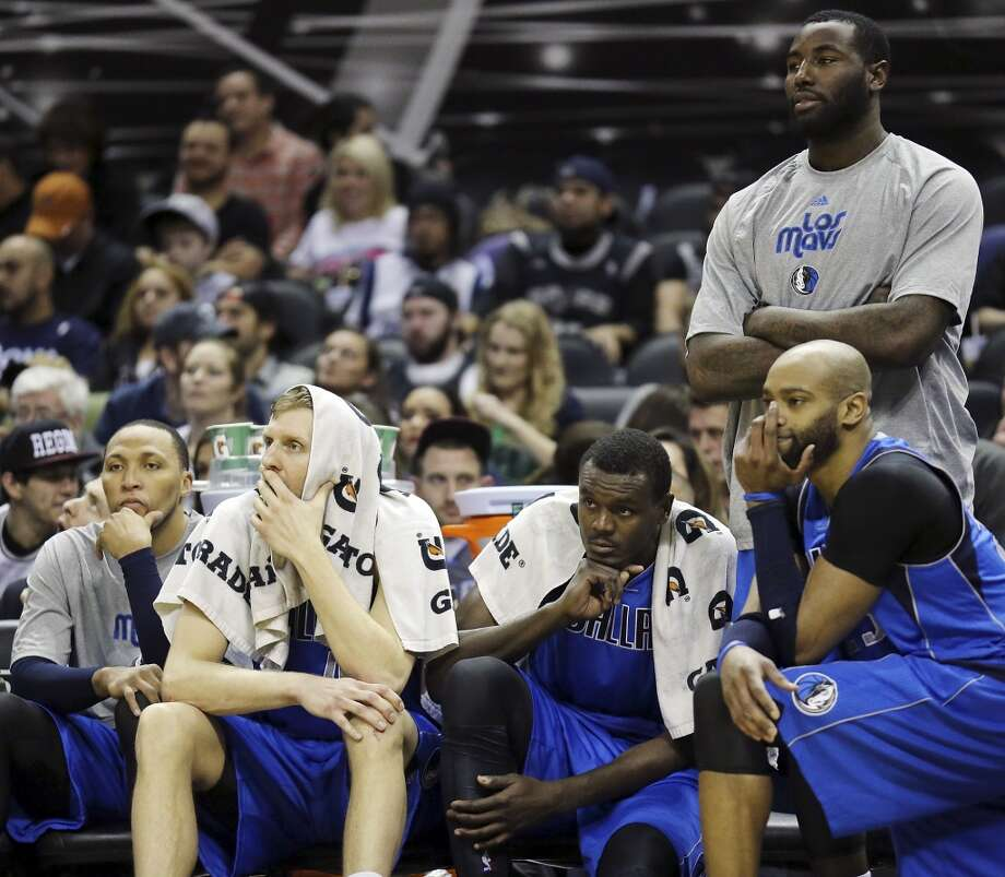 Dallas Mavericks' Shawn Marion (from left), Dirk Nowitzki, Samuel Dalembert, Vince Carter, and DeJuan Blair watch action against the San Antonio Spurs late in the game Sunday March 2, 2014 at the AT&T Center. The Spurs won 112-106. Photo: San Antonio Express-News